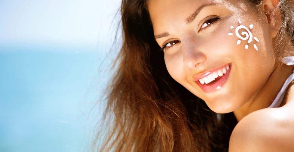 Suntan Lotion Woman Applying Sunscreen Solar Cream. Beautiful ha